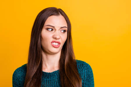 Close up photo amazing beautiful her she lady restricting disgusted look side empty space ugh facial expression spoiled food eat wearing green knitted pullover jumper isolated yellow background