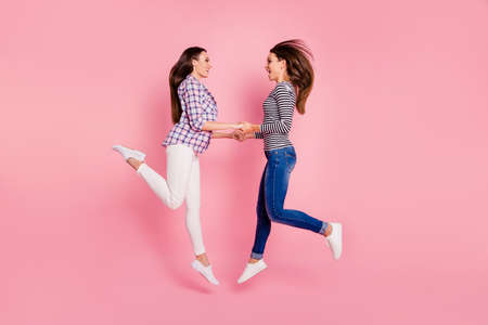 Profile side full length body size photo of cute carefree charming fellowship fooling having promenade laughter isolated scream feel glad rejoice wearing denim clothing shirts on pink background
