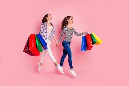 Full length body size photo of cheerful hipsters amazed moving running for purchases addicted discount have weekends wearing modern denim outfit sneakers isolated on pastel background