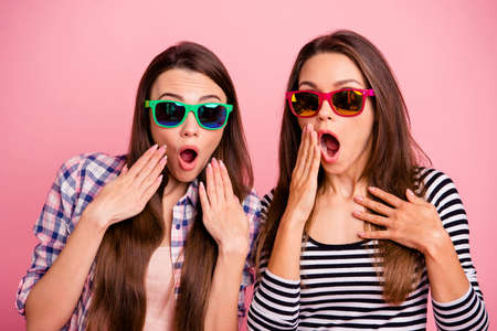 Really Close up portrait crazy funny hipsters eye glasses impressed incredible news cant believe scream shout touch hand cheek mouth wear bright modern clothes isolated rose-colored background