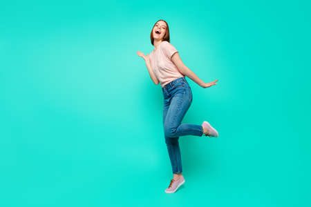 Full length side profile body size photo beautiful funky her she lady pretty appearance make strange moves motion wear casual jeans denim pastel t-shirt clothes isolated teal turquoise background Stock Photo