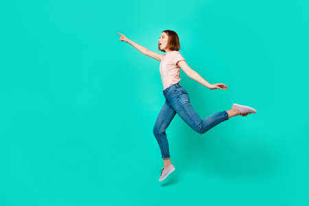 Full length side profile body size photo beautiful amazing her she lady flight look empty space new unknown road please help wear casual jeans denim pastel t-shirt isolated teal turquoise background 写真素材 - 121965924