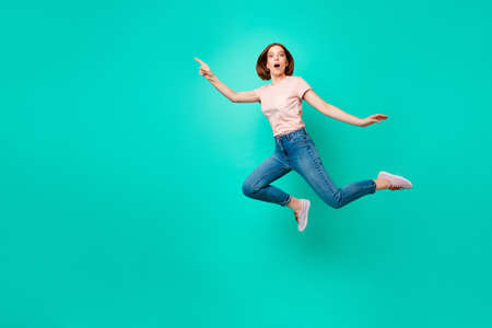 Full length body size photo beautiful amazing her she lady flight jump high indicate empty space new low little prices wear casual jeans denim pastel t-shirt isolated teal turquoise background