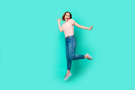 Full length side profile body size photo beautiful amazing her she lady jumping high pretty appearance short straight hairdo wear casual jeans denim pastel t-shirt isolated teal turquoise background