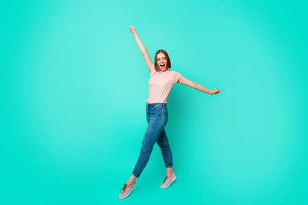 Full length side profile body size photo beautiful her she lady yell scream shout walk street park fresh air wear casual jeans denim pastel t-shirt clothes isolated teal turquoise background Standard-Bild