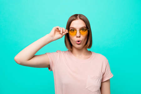 Close up photo beautiful her she lady modern fashionable look short straight hair opened mouth big eyes wondered expression unexpected wear specs casual t-shirt isolated teal turquoise background