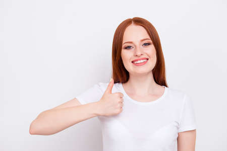 Close up photo amazing beautiful she her lady long straight hair hand arm thumb up tested quality production advising buy buyer wear casual t-shirt outfit clothes isolated white light background