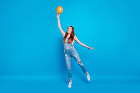 Full length body size photo beautiful amazing she her lady weekend play air balloon eventually start begin flight up sky unexpected wear casual jeans denim overalls clothes isolated blue background 写真素材 - 122124899
