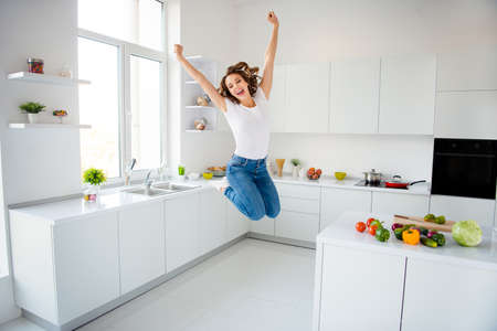 Full length body size view of her she nice attractive lovely girlish cheerful cheery glad slim fit thin slender wavy-haired girl having fun great cool time in modern light white interior style room