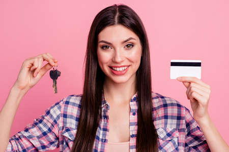 Close-up portrait of her she nice-looking attractive cute charming shine lovely cheerful cheery straight-haired lady recommending new flat buying isolated over pink pastel background