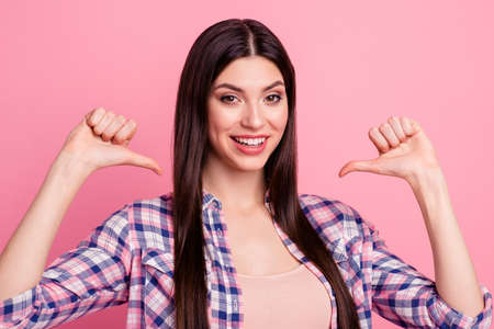 Close-up portrait of her she nice-looking attractive cute charming well-groomed lovely cheerful cheery straight-haired lady pointing thumbs at herself isolated over pink pastel background