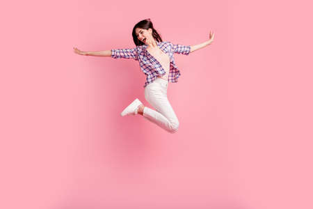 Full length side profile body size photo yell amazing beautiful her she lady jump high sporty competition wear shoes casual checkered plaid shirt white jeans denim clothes isolated pink background 写真素材 - 122126250