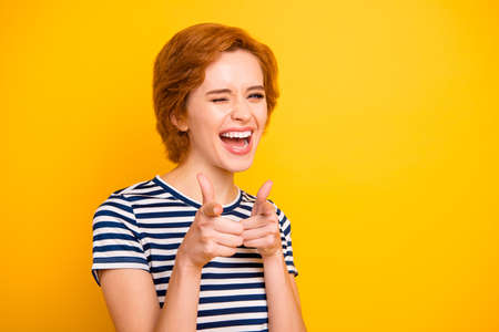 Close up photo beautiful amazing she her lady easy-going point index fingers hey you lets hang out wearing casual striped white blue t-shirt outfit clothes isolated yellow bright vibrant background