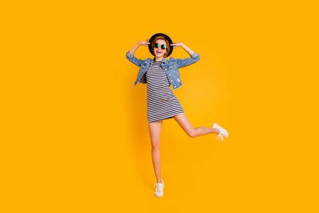 Full length body size view portrait of nice lovely charming attractive cheerful cheery optimistic carefree girl flying on air free spare time isolated over bright vivid shine yellow background