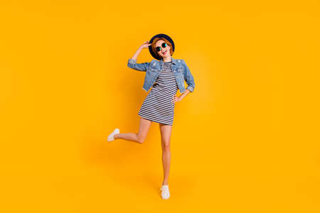 Full length body size view portrait of nice charming attractive cheerful optimistic carefree careless girl flying on air free spare time lifestyle isolated over bright vivid shine yellow background Stock Photo