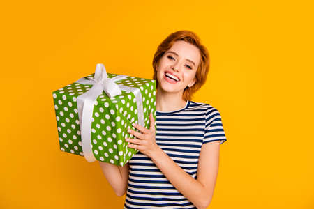 Portrait of her she nice lovely pretty charming attractive cheerful cheery girl get receive holding in hands big large green box purchase isolated over bright vivid shine yellow background Standard-Bild - 121938154