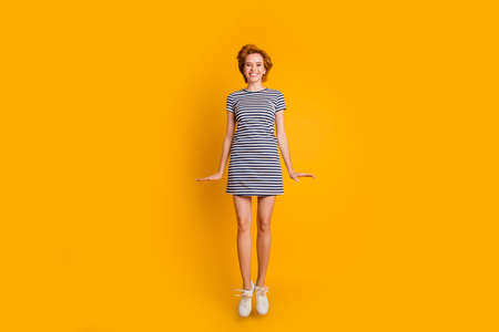Full length body size view portrait of her she nice lovely pretty charming attractive cheerful cheery optimistic girl jumping up in air free time isolated over bright vivid shine yellow background