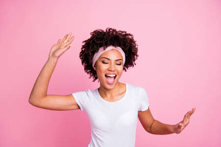 Close up photo beautiful funky amazing she her dark skin lady club person hang out having fun dancing queen hip-hop modern moves wear head scarf casual white t-shirt isolated pink bright background