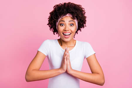 Close up photo beautiful funky amazing she her dark skin lady funny praying symbol ask please buy me this clothes dress jacket wear head scarf casual white t-shirt isolated pink bright background
