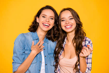 Close up photo of charming lovely fellowship fellows touch chest laughter funny funky hear humor joke have holidays weekends dressed modern summer outfit isolated on yellow background.