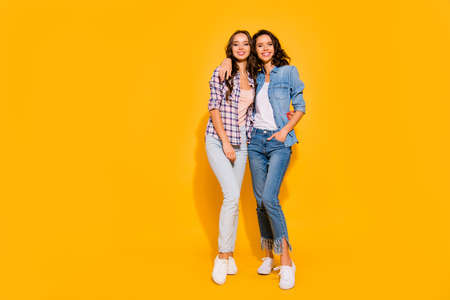 Full length body size view photo nice charming ladies youth cudling free time weekends summer glad content candid dressed checkered denim suit legs fashionable sneakers isolated colorful background