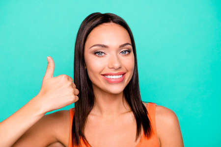 Close up photo portrait of pretty attractive nice optimistic gorgeous she her lady making giving finger up isolated pastel background. Stock Photo