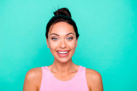 Closeup photo portrait of pretty lovely cute charming cool she her lady with toothy beaming teeth smile wearing bright singlet isolated pastel background