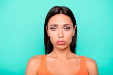 Closeup photo portrait of unsatisfied tired crying with tears she her lady with pouted lips isolated bright pastel teal background Imagens