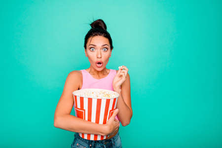 Close up photo beautiful funky crazy she her lady trendy stylish hairstyle hold hands arms corns container eyes full fear scary movie wear casual tank-top isolated bright teal turquoise background