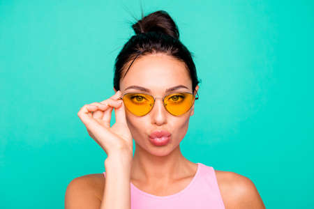 Close up photo beautiful amazing she her lady funny trendy hairstyle hold hand arm modern sun specs send air kiss boyfriend flirt wear casual pink tank-top clothes isolated teal turquoise background