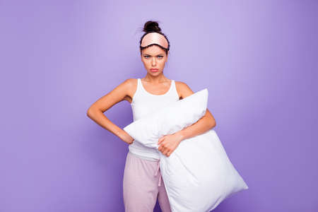 Close up photo beautiful negative her she lady hands arms palms hold big large pillow not fear situation expression wear sleeping pink mask white tank-top pajama isolated purple violet background