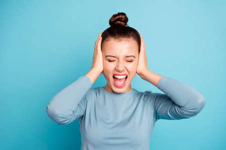 Close-up portrait of her she nice-looking attractive lovely winsome mad depressed girl shouting loudly closing ears isolated over bright vivid shine turquoise background