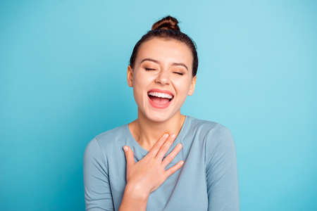 Close up photo beautiful amazing funky she her lady eyes closed overjoyed laughing out loud yell scream shout joke humorous story wear casual sweater pullover isolated blue bright background