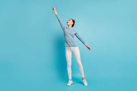 Full length body size view photo cute pretty teen teenager try catch holiday feel content glad idea creative enjoy rejoice candid modern pullover white trousers sneakers isolated bright background
