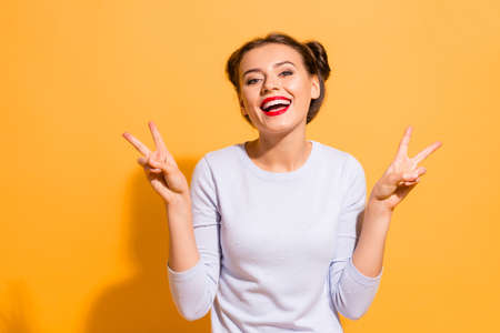 Portrait of her she nice-looking attractive stunning winsome sweet lovely cheerful cheery optimistic girl showing double v-sign isolated over bright vivid shine yellow background