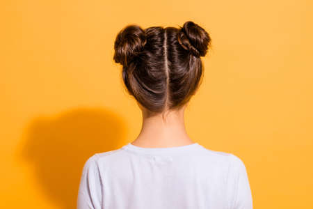 Back side view close up photo of nice pleasant young woman in white clothing showing her new haircut made by hairdresser isolated over vivid yellow background