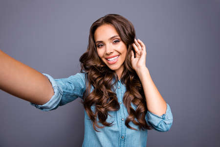Close up photo amazing beautiful perfect white teeth toothy her she lady make take selfies hair styling advice new stylist wearing casual jeans denim shirt clothes outfit isolated grey background. 版權商用圖片