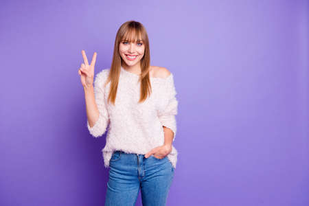 Portrait of her she nice-looking attractive winsome lovely lovable fascinating cheerful straight-haired girl showing v-sign isolated over bright vivid shine violet purple background