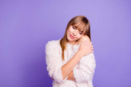 Close-up portrait of her she nice-looking attractive lovely sweet gentle fascinating dreamy lovable straight-haired girl hugging herself isolated on bright vivid shine violet purple background