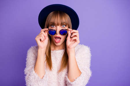 Close-up portrait of her she nice-looking attractive winsome lovely fascinating straight-haired lady putting off round glasses isolated on bright vivid shine violet purple background