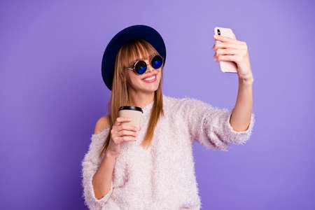 Portrait of her she nice-looking attractive lovely pretty winsome cheerful straight-haired lady taking making  selfie speed blog smm isolated on bright vivid shine violet purple background