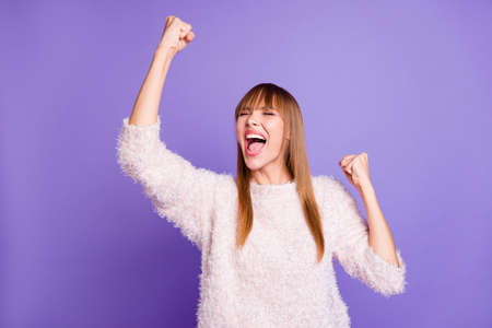Portrait of her she nice-looking attractive winsome fascinating lovely cheerful straight-haired lady win winner satisfaction attainment isolated on bright vivid shine violet purple background