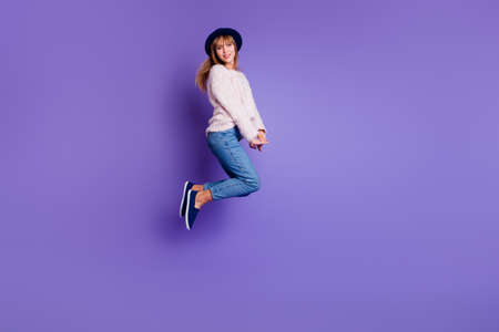 Full length body size view photo charming pretty attractive teen teenager have holidays  rejoice candid content isolated sweater modern denim blue sneakers colorful background