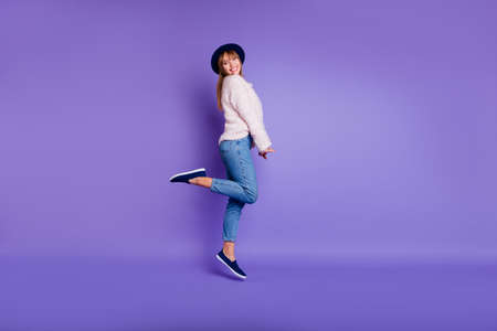 Full length body size view photo cute pretty funny youth people person have holidays  candid glad amazed isolated dressed sweater modern jeans fashionable blue sneakers purple vivid background 写真素材
