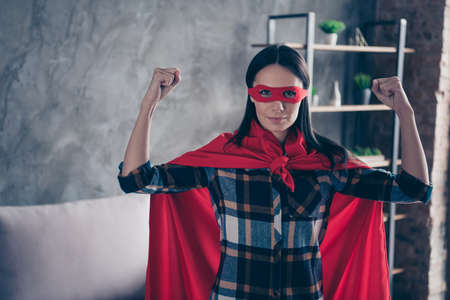 Close up photo beautiful funky she her superpower lady dynamic comics costume women equal rights concept strong hands arms wear red eye mask mantle home living room loft apartment flat indoors