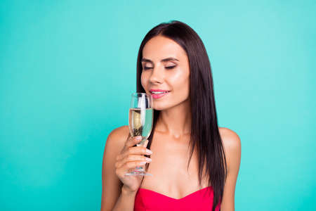 Close up photo beautiful amazing she her lady try new expensive little drunk hold arm hand golden wine glass great aroma festive party formal-wear red dress isolated teal turquoise bright background