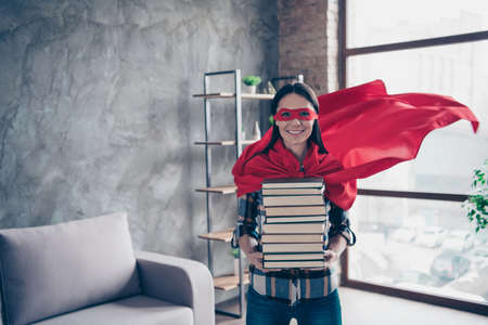 Close up photo beautiful she her superpower lady comics costume women equal rights strong hands arms hold many lot books wear red eye mask flying mantle house living room loft flat indoors