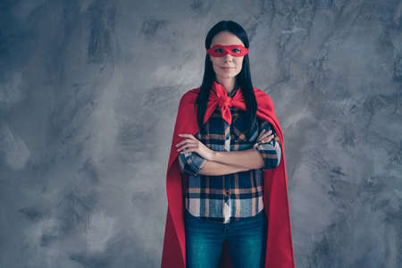 Close up photo beautiful fearless she her superpower lady comics costume heroine women equal rights concept strong hands arms together wear red eye mask mantle home room loft apartment flat indoors