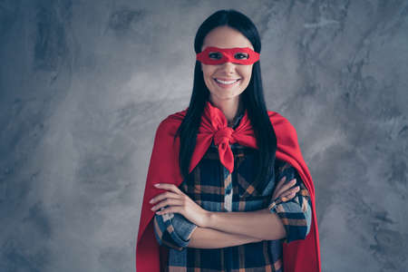 Close up photo beautiful fearless amazing she her superpower lady comics costume heroine women equal rights concept strong hands arms wear red eye mask mantle home room loft apartment flat indoors
