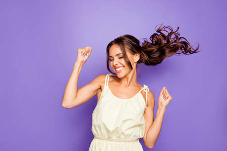 Close up photo of pretty attractive optimistic lovely she her lady raising fists hands up having free freedom inspiration isolated violet background Banque d'images